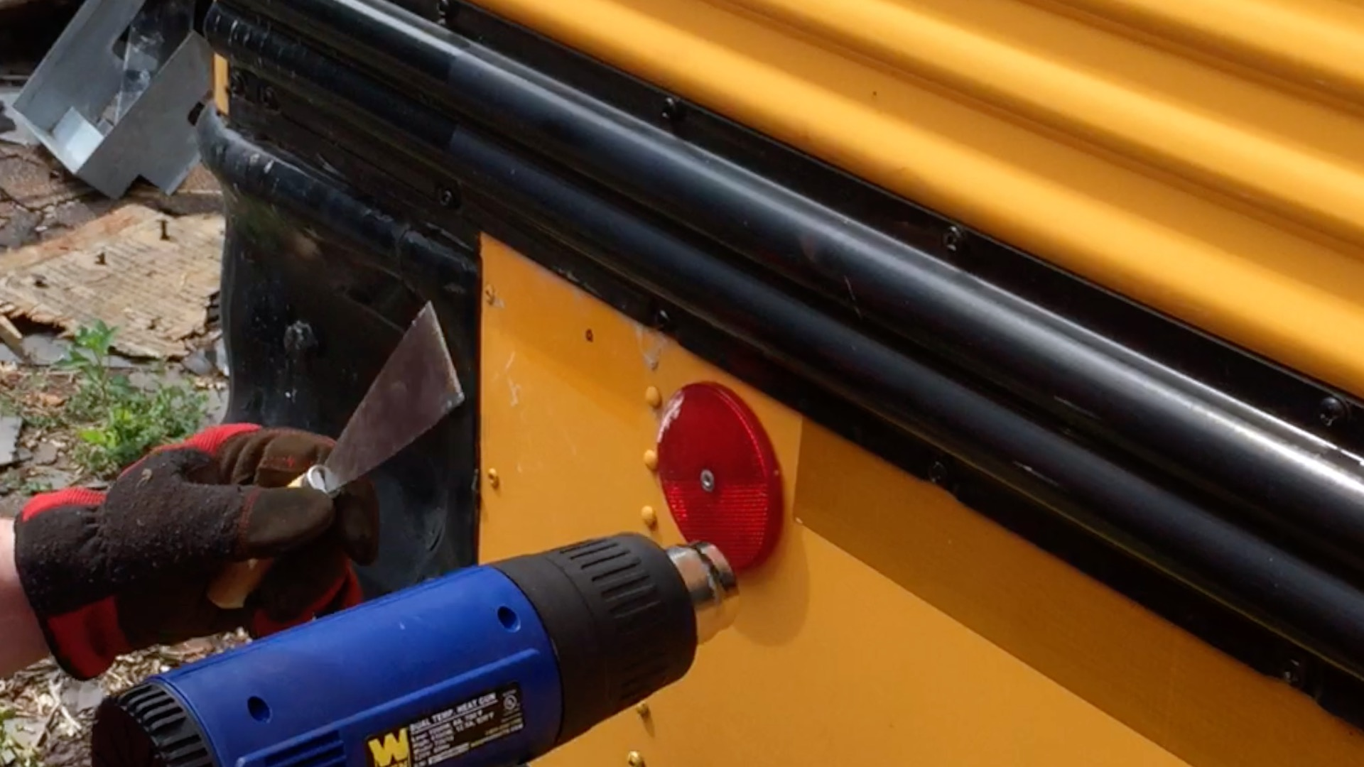 Removing Reflective Tape From a School Bus
